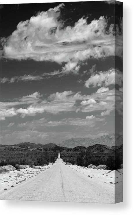 Photography Canvas Print featuring the photograph Remote Desert Road To Mountains by Panoramic Images