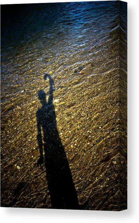 Shadow Canvas Print featuring the photograph Shadow On The Water by Joel Loftus