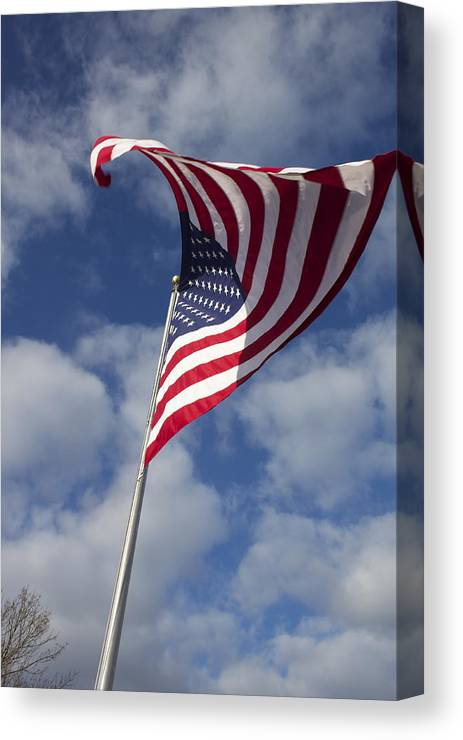United States Flag Canvas Print featuring the photograph The Flag Was Still There by Jeannette Cruz