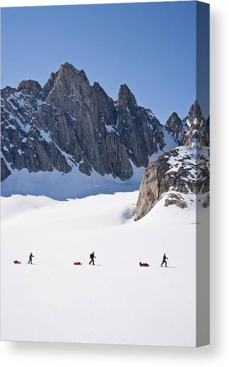 Adventure Canvas Print featuring the photograph Three People Ski-tour On Karale Glacier by Henry Georgi