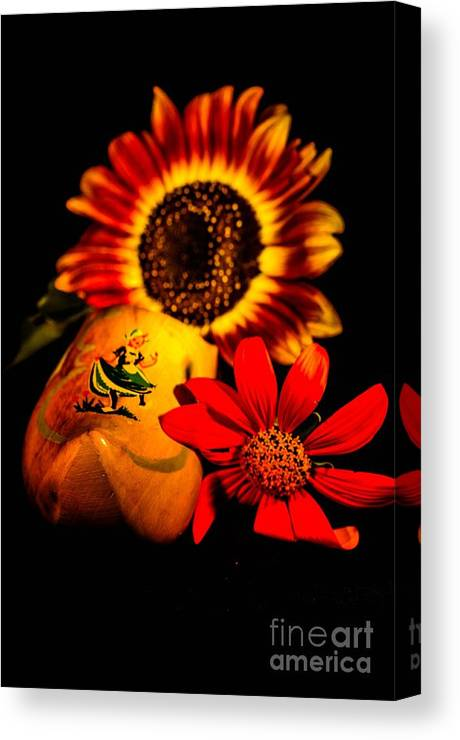 Canvas Print featuring the photograph Woold Shoe With Flowers by Gerald Kloss