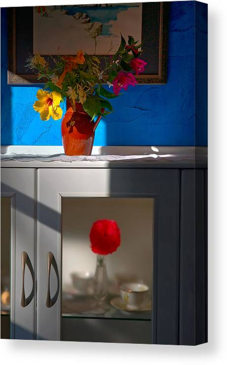Yellow Flower Canvas Print featuring the photograph Yellow Flower In A Vase Of Clay. by Juan Carlos Ferro Duque