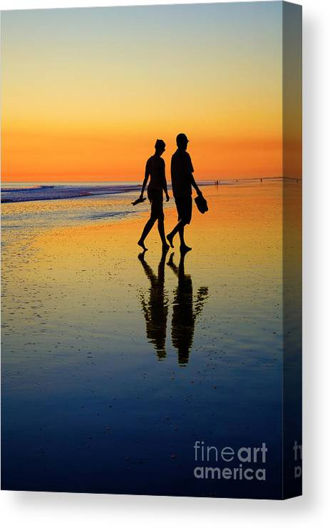 938c63cb91d Young Canvas Print featuring the photograph Young Couple On Romantic Beach  At Sunset by Colin and