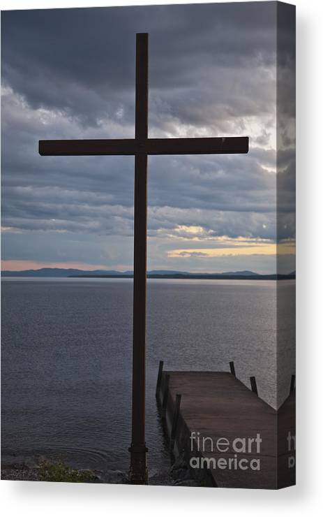 Christianity Canvas Print featuring the photograph Cross By Lake by Kathleen Smith