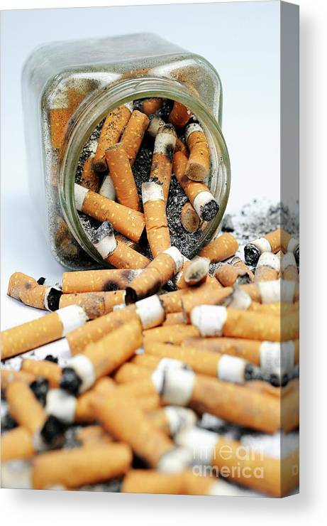 Ugliness Canvas Print featuring the photograph Jar Overflowing With Cigarette Butts by Sami Sarkis