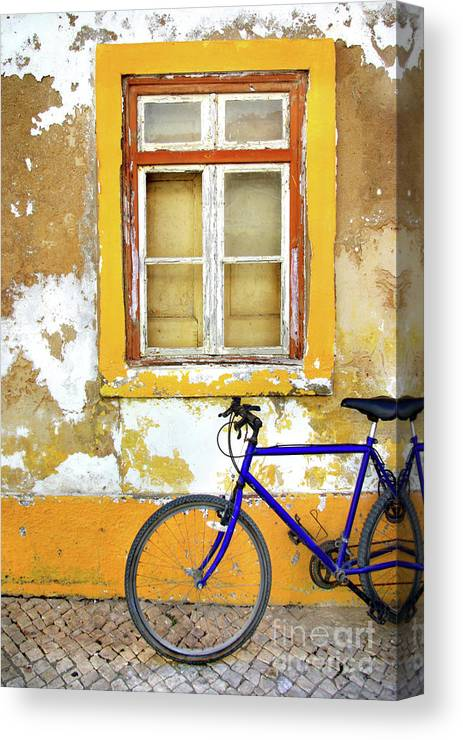 Aged Canvas Print featuring the photograph Bike Window by Carlos Caetano