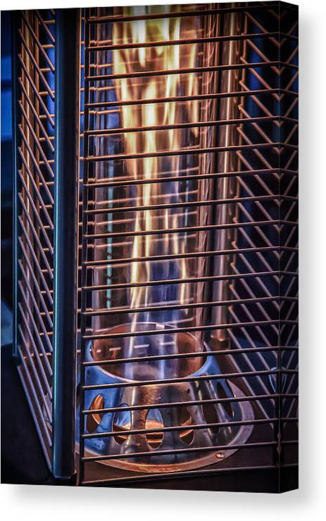 Fire Canvas Print featuring the photograph Caged Fire by James Woody