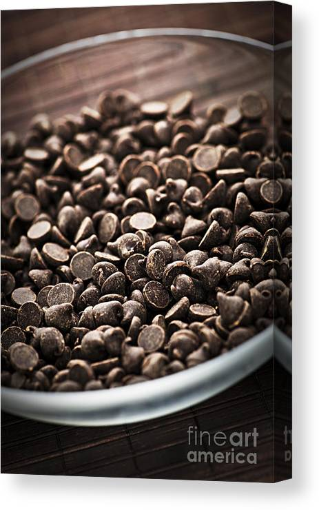 Chocolate Canvas Print featuring the photograph Dark Chocolate Chips by Elena Elisseeva