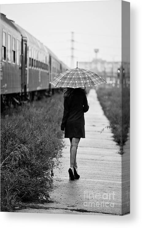 Woman Canvas Print featuring the photograph Leaving by Gabriela Insuratelu