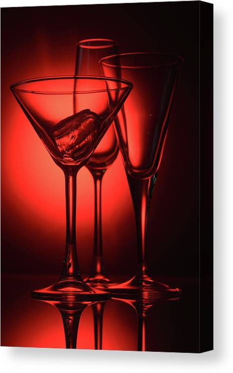 Alcohol Canvas Print featuring the photograph Three Empty Cocktail Glasses On Red Background by Oleg Yermolov