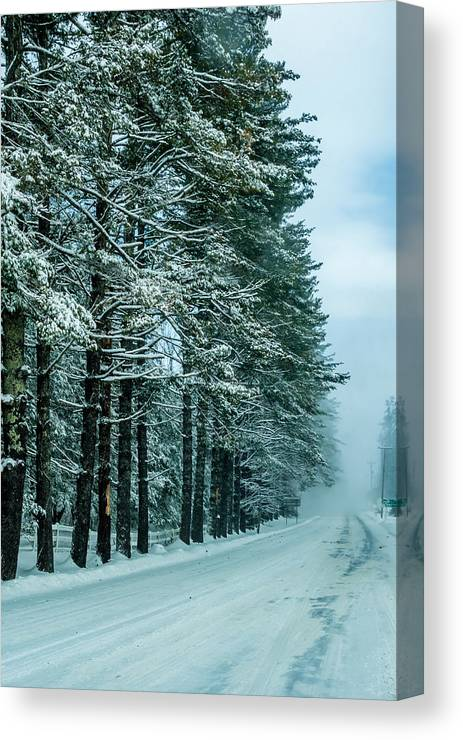 Bad Canvas Print featuring the photograph Bad Road Conditions While Driving In Winter by Alex Grichenko