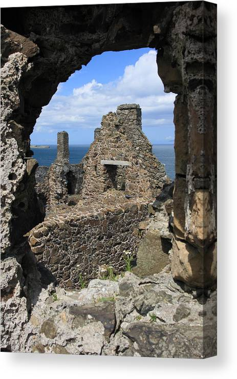 Dunluce Canvas Print featuring the photograph Dunluce Castle Northern Ireland by Pierre Leclerc Photography