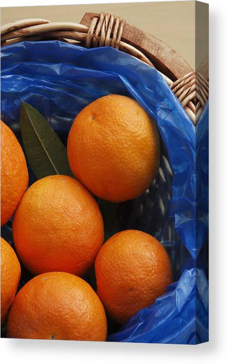 Crete Canvas Print featuring the photograph A Basket Of Oranges by Steve Outram