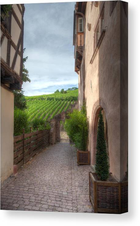 Old Canvas Print featuring the photograph A Small Side Street In Riquewihr by W Chris Fooshee