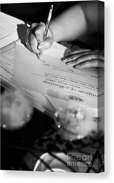 Wedding Canvas Print featuring the photograph Bride Signing Name On Marriage Register Contract by Jorgo Photography - Wall Art Gallery