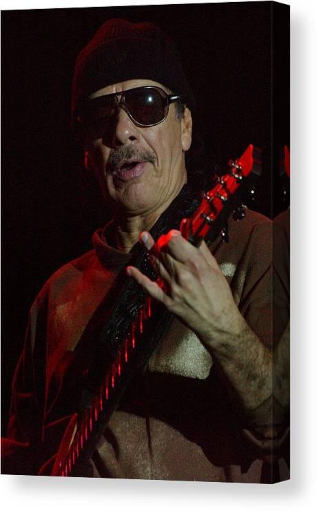 Carlos Santana. Santana. Memphis In May Canvas Print featuring the photograph Carlos Santana by Bob Guthridge