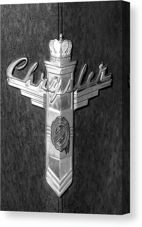 Car Canvas Print featuring the photograph Chrystler Emblem by Audrey Venute