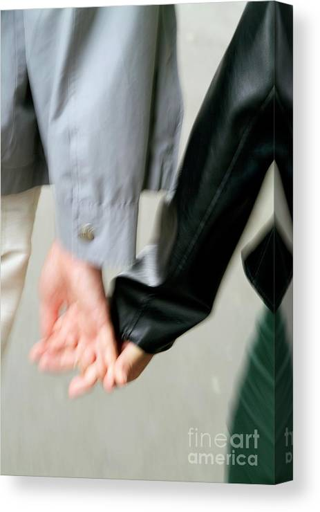 Adult Canvas Print featuring the photograph Couple Holding Hands While Strolling Down The Street by Sami Sarkis