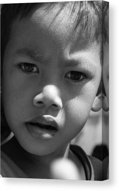 B&w black & White Child Cambodian Curious Canvas Print featuring the photograph Curious Cambodian Child by Linda Russell