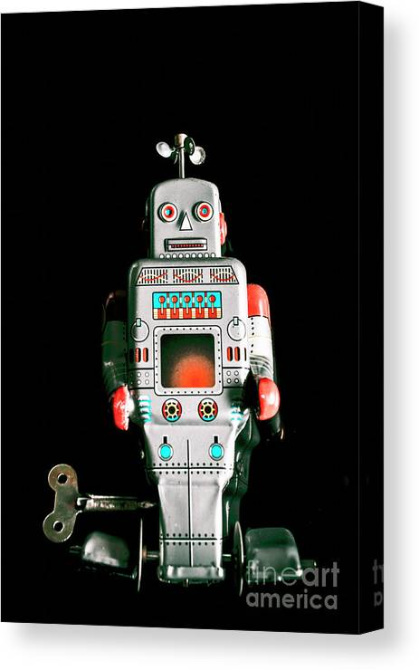 Robot Canvas Print featuring the photograph Cute 1970s Robot On Black Background by Jorgo Photography - Wall Art Gallery