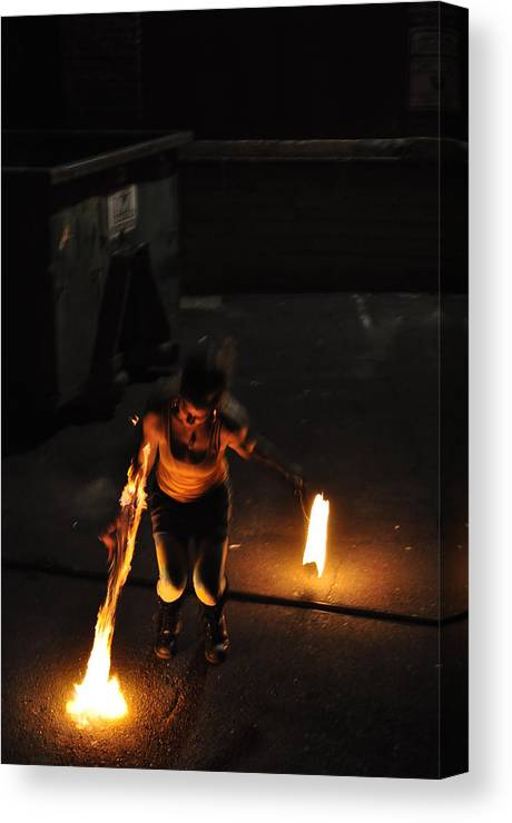 Fire Twirler Canvas Print featuring the pyrography Fire Throw by Joseph Cusano IV