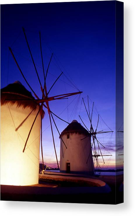 Architecture; Architectural; Cyclades; Mykonos Canvas Print featuring the photograph Greece. Mykonos Town. Illuminated Windmills At Dusk. by Steve Outram