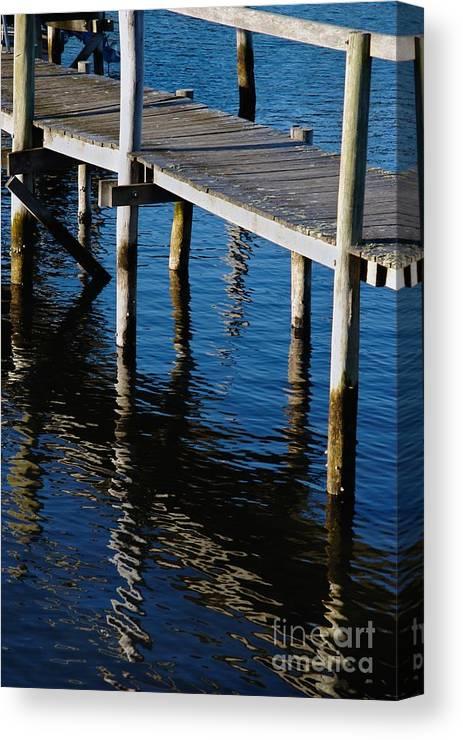 Pier Canvas Print featuring the photograph Pier Reflection by Hideaki Sakurai