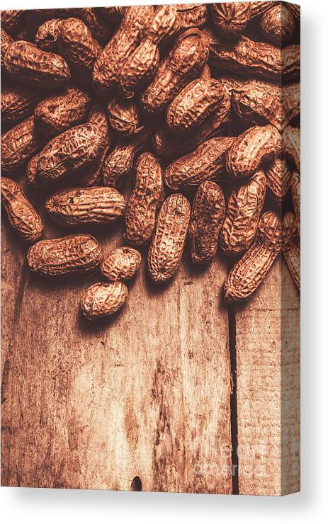 Kitchen Canvas Print featuring the photograph Pile Of Peanuts Covering Top Half Of Board by Jorgo Photography - Wall Art Gallery