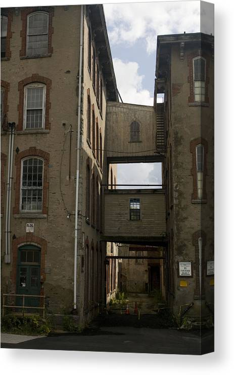 Mill Canvas Print featuring the photograph Rundown Alley by Jeff Porter
