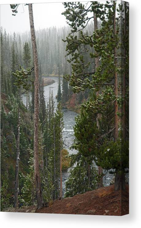 Snow Canvas Print featuring the photograph Snow On The Yellowstone River by Gary Langley