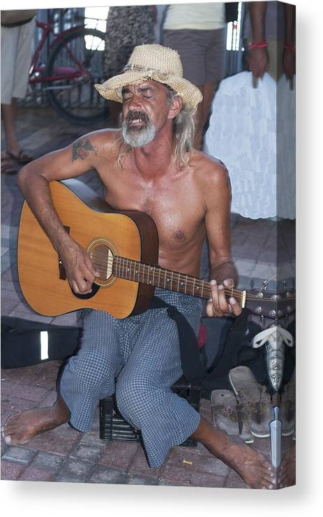 Guitar Canvas Print featuring the photograph Strumming A Tune In Key West by Carl Purcell