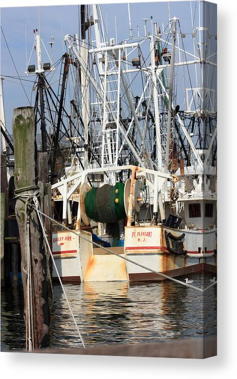 Fishing Boat Canvas Print featuring the photograph Tied Up by Mary Haber