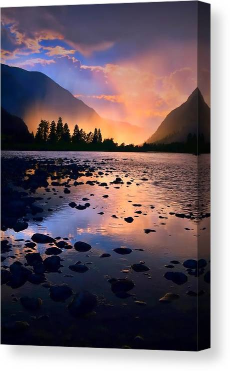Rocks Canvas Print featuring the photograph When The Rain Falls And The Sun Sets by Tara Turner