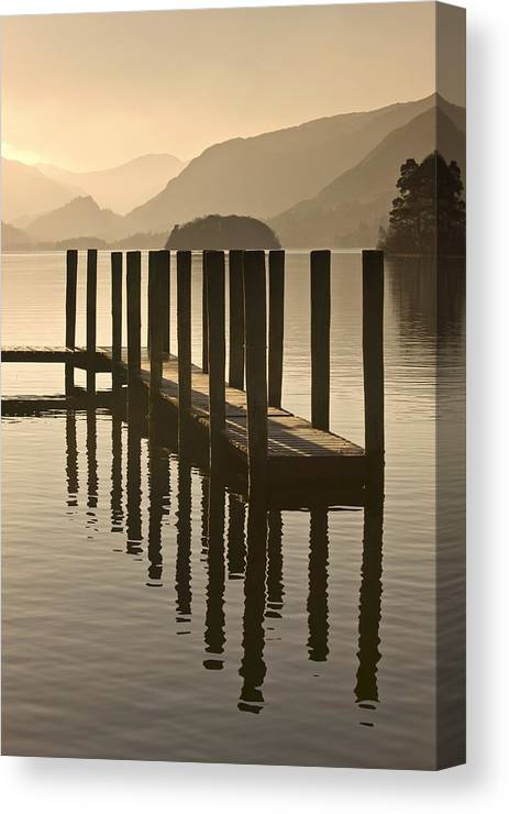 Calm Canvas Print featuring the photograph Wooden Dock In The Lake At Sunset by John Short