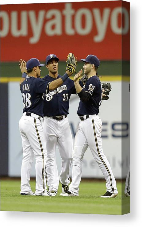 People Canvas Print featuring the photograph Ryan Braun, Gerardo Parra, And Carlos Gomez by Mike Mcginnis
