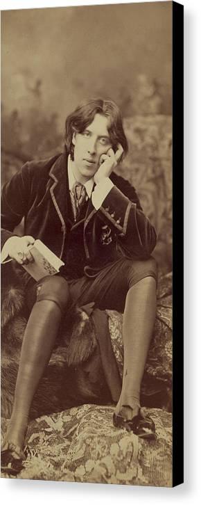 Oscar; Wilde; Irish; Writer; Poet; Author; Dandy; Photograph; Sepia; Black; White; Velvet; Smoking; Jacket; Breeches; Wearing; Stockings; Full; Length; Seated; Oscar Wilde Canvas Print featuring the photograph Oscar Wilde 1882 by Napoleon Sarony
