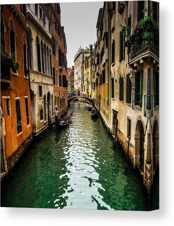 Venice Canvas Print featuring the photograph Canal In Venice by Jason Schwass