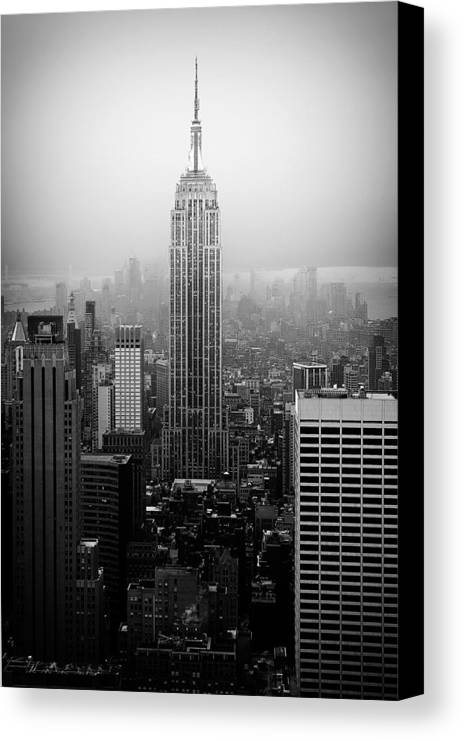 Empire State Building Canvas Print featuring the photograph The Empire State Building In New York City by Ilker Goksen