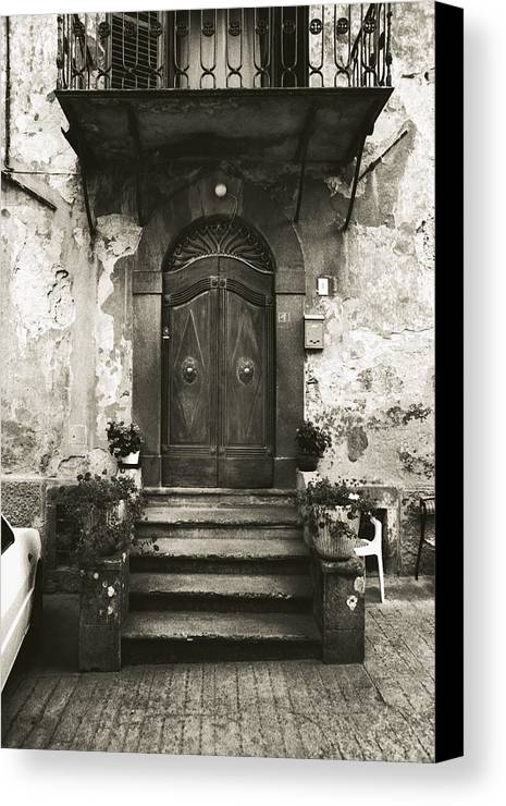 Italy Canvas Print featuring the photograph Barga Door by Tom Kostro