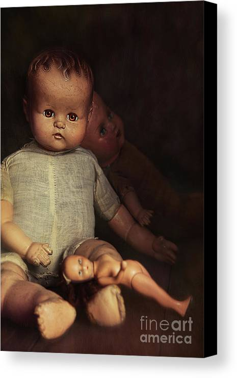 Atmosphere Canvas Print featuring the photograph Old Dolls Sitting On Wooden Table by Sandra Cunningham