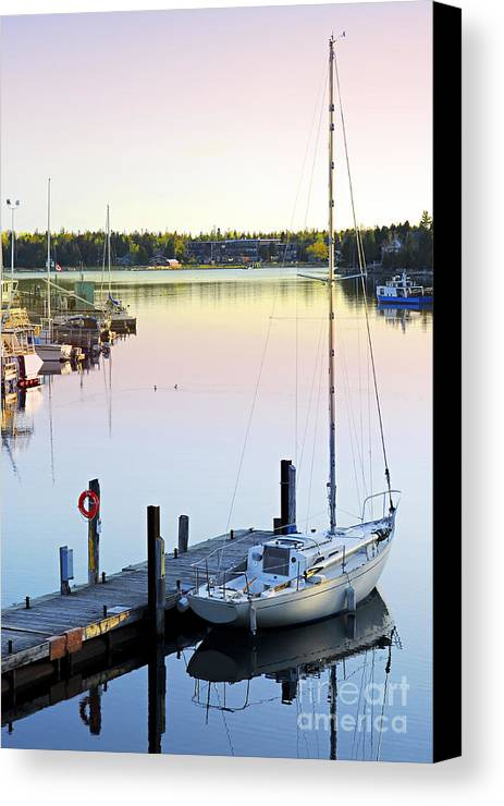 Boat Canvas Print featuring the photograph Sailboat At Sunrise by Elena Elisseeva