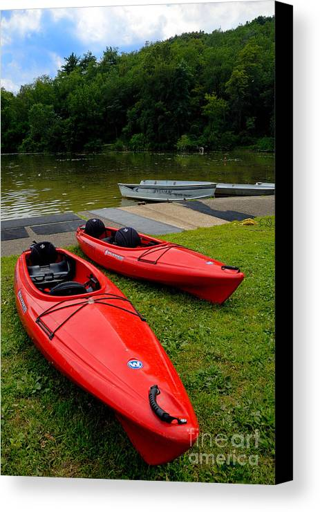 2 Seat Canvas Print featuring the photograph Two Red Kayaks by Amy Cicconi