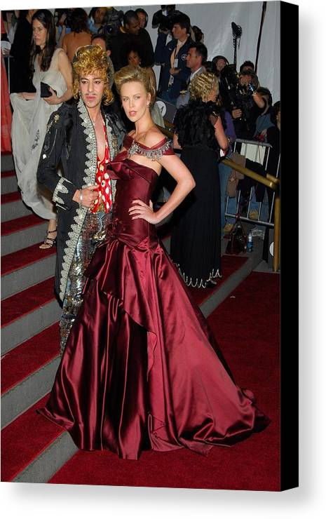 Anglomania Tradition And Transgression In British Fashion Opening Gala Canvas Print featuring the photograph John Galliano, Charlize Theron Wearing by Everett
