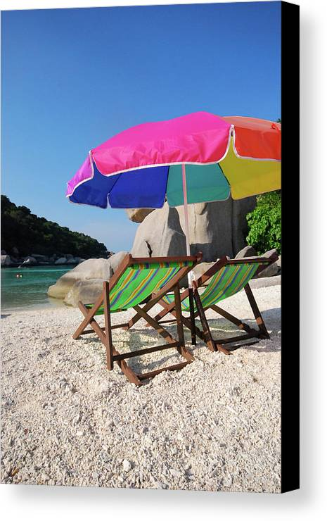 Vertical Canvas Print featuring the photograph Deck Chairs On A Beach In Thailand by Thepurpledoor