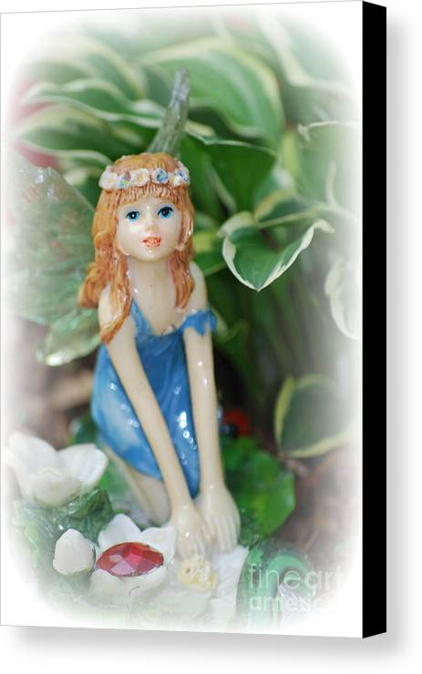 Fairy Canvas Print featuring the photograph Fairy In Flowerbed by Lila Fisher-Wenzel