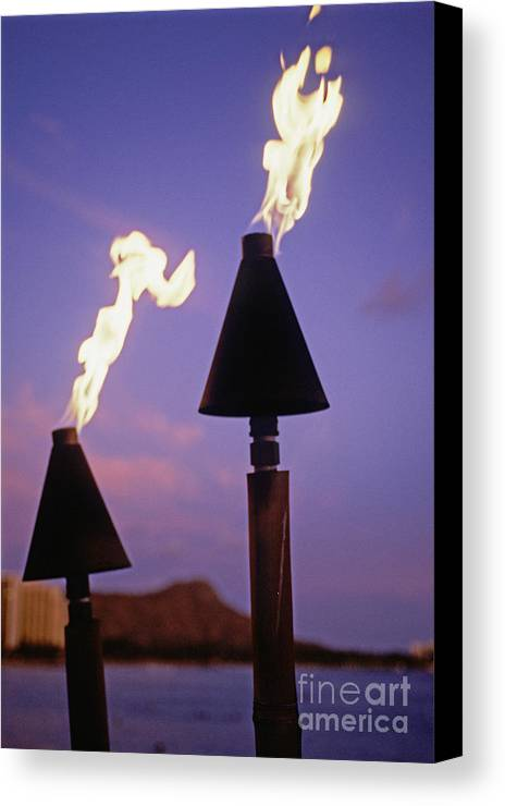 Burn Canvas Print featuring the photograph Waikiki, Tiki Torches by Carl Shaneff - Printscapes