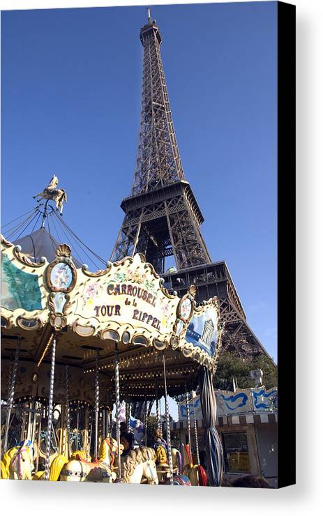 Eiffel Tower Canvas Print featuring the photograph Eiffel Tower And Ancient Carousel by Charles Ridgway