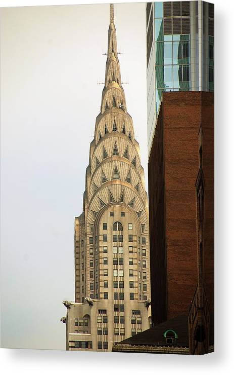 Buildings Canvas Print featuring the photograph Chrysler Building by John Schneider