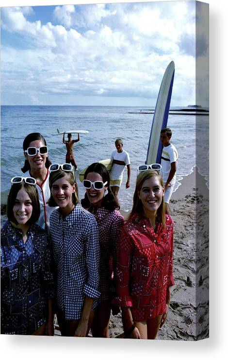 Fashion Canvas Print featuring the photograph Models And Surfers On A Beach by William Connors