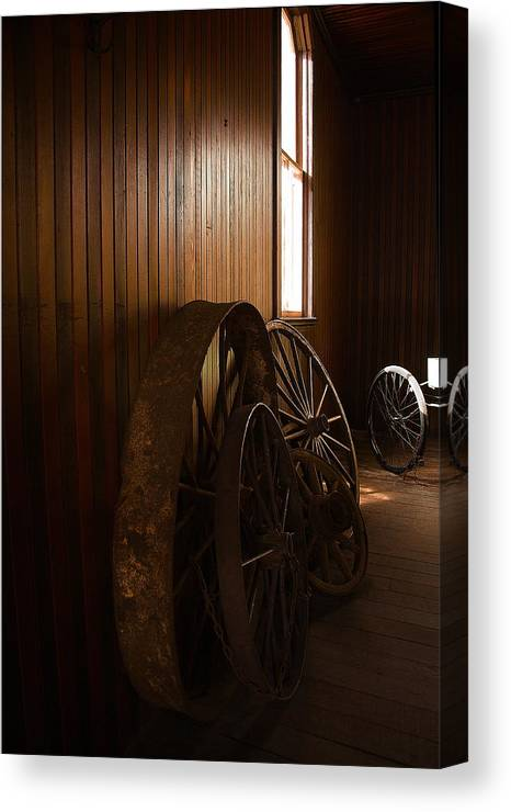 Horseless Canvas Print featuring the photograph Old Wheels by Viktor Savchenko